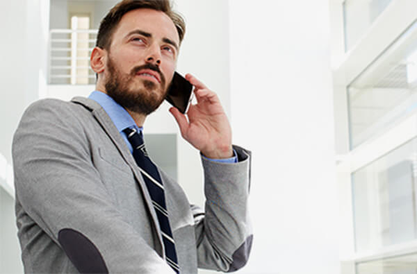 man in suit talking on the phone